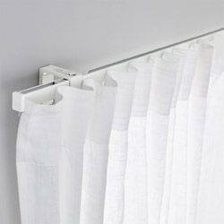 IKEA VIDGA white single track set is the fastest way to hang up a pair of curtains: mount the brackets, click parts together, and slide curtains in. You're done!