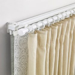 IKEA VIDGA triple track and curtain rod set can be used to create several layers of curtains for privacy, reducing noise, temperature, or blocking sunlight.