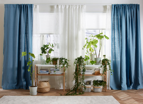 We paired IKEA VIDGA white single track rails and long wall brackets to mix sheer and blue semi-sheer curtains to customize the amount of light in the room.
