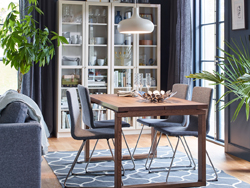 A brown and gray dining setting with four, comfortable, upholstered VOLFGANG chairs in chrome and medium grey and MÖRBYLÅNGA table in oak veneer.