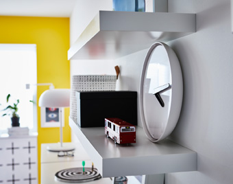 A wall shelf, with its concealed mounting hardware, creates a sense of being one with the wall it's sitting on.