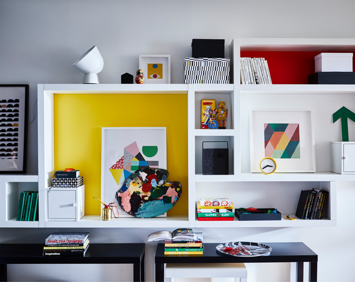 Using a combination of whole and cut up LACK wall shelves, used both horizontally and vertically, a Mondrian-inspired patchwork is created.