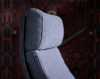 With its high, gently curved back and headrest, relaxation comes naturally when sitting down in POÄNG.