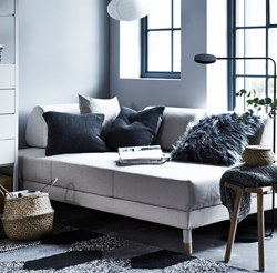 No backrest and firm, loose cushions set the character for FLOTTEBO, a sofa bed with a both flexible and strong expression. Modern, accessible design – and storage space to boot.