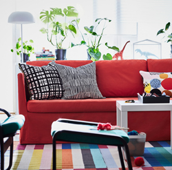 BRÅTHULT is a sofa in modern, clean design, with narrow armrests, generous size, and floor-length, washable covers – here in a bright reddish colour and matched to form a strong expression.