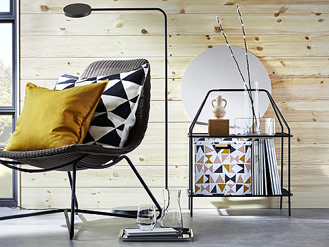 Reach for magazines and small accessories in the modern IKEA YPPERLIG dark gray magazine stand, co-designed with Danish design company HAY. Its two thin metal shelves, slim bars, low weight and height make it easy to move around the home or office.