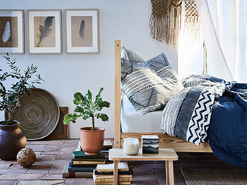 Curl up in a cozy bed styled with IKEA PROVINSROS quilt cover and pillowcase bedding set. Its calming white and light blue colors suit a bedroom, while its angled line pattern mimics the rusticity of the desert.