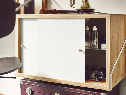 Besides storage inside and handy surface on top, the sliding doors of a SVALNÄS cabinet stay in their place – just as open or closed as you like.