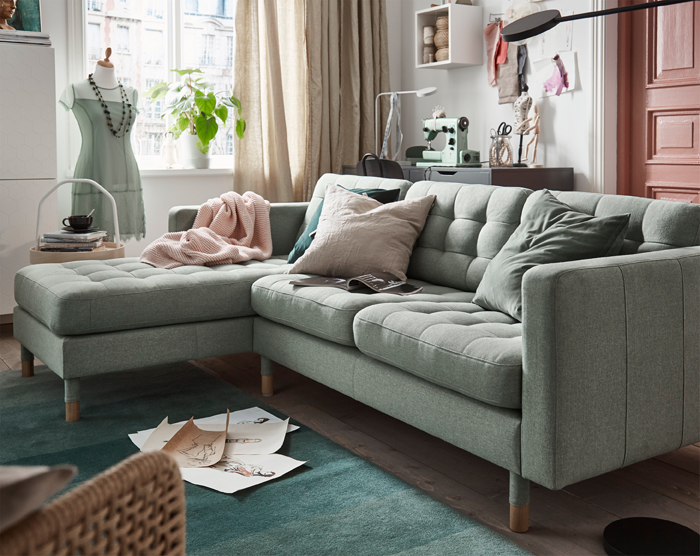 IKEA LANDSKRONA is a retro-style sofa with buttoned seats, resilient cushions, marked legs, and an overall touch of elegance.