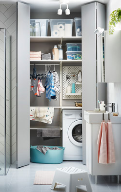 IKEA ALGOT upright shelves and LILLÅNGEN washbasin work well together to create a bathroom and laundry solution, even in the smallest of spaces.