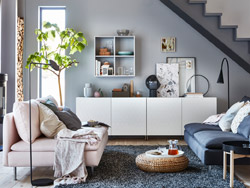 IKEA BESTÅ closed storage cabinet system and new VASSVIKEN honeycomb doors work together to create a modern living room with smart and stylish storage.