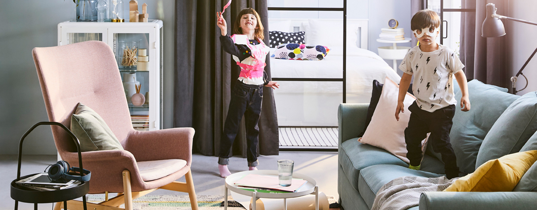 The 2019 IKEA Catalogue cover shows two children playing in a living room. They're excited the catalogue is out and that you can browse it as an ebook.