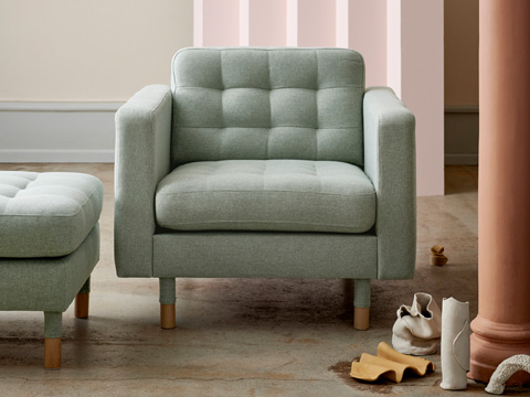 1960s inspired LANDSKRONA armchair and ottoman shown in light green.