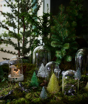 Kick off the illusion with forest green IKEA FEJKA art plants and miniature Christmas trees so realistic, you can almost smell the fragrance of pine and nature.