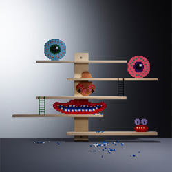 These flexible and multifunctionalIKEA LUSTIGT shelves can easily be movedsideways, or used to displayfavourite toys.