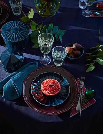 IKEA VINTER 2018 wine glasses on a holiday Christmas set dining table with rich jewel toned dishes and decor.