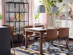 IKEA MÖRBYLÅNGA oak veneer brown dining table and BERNHARD golden brown chairs are a modern dining room solution duo with straight lines and edges.