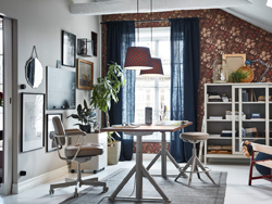 The IKEA IDÅSEN beige sit stand work desk, drawer unit and glass storage cabinet are functional and modern pieces to make your home office more balanced.