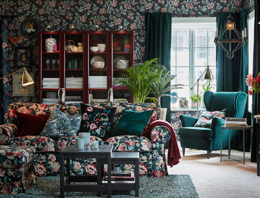 Decked out in floral walls and dark green colours, IKEA EKTORP sofa and footstool are covered in a vintage flower pattern to help this bold, stylish look.