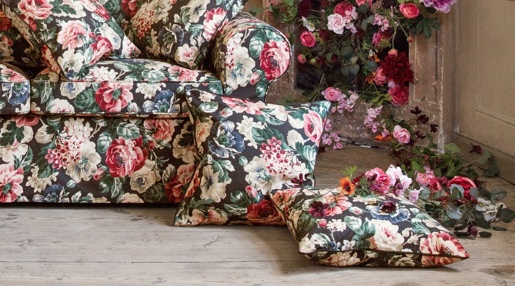 Embrace florals a little with LEIKNY cushion cover or a lot with matching covers for sofas and armchairs. The cushion cover from IKEA has a big, multicolored floral pattern on a black background.