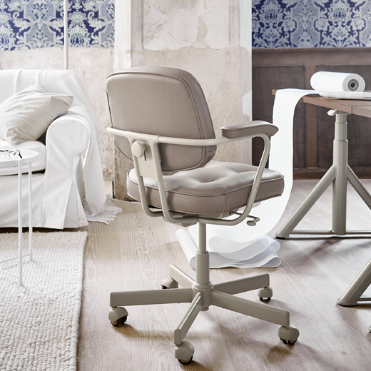 From behind, the side or the front ALEFJÄLL swivel chair blends in with its traditional style and materials like beige leather and metal frame. Made by IKEA, it's designed for modern ergonomics too.