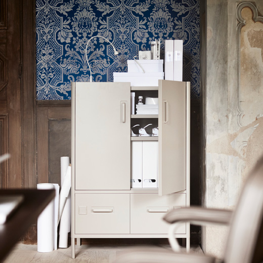Hide your work using IDÅSEN cabinet with doors and drawers. The high cabinet from IKEA has an industrial look in beige steel with side-by-side bottom drawers.