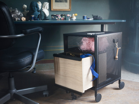 Get organised at home or the office with movable BEKANT storage unit on castors from IKEA. It has a black mesh frame and a spacious oak veneer drawer.