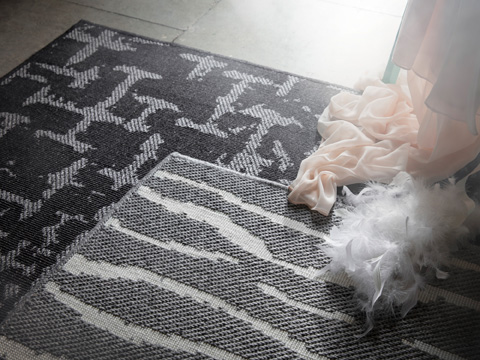 In monochrome greys, GLUMSÖ rugs from IKEA have lively patterns that easily fit in any room. The soft rugs have a silky sheen from 100% lyocell, a renewable material.