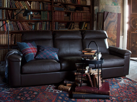Relax in a timeless LIDHULT three-seat sofa section from IKEA. Designed with traditional style, this dark brown leather cover complements its generous size and comfy support.
