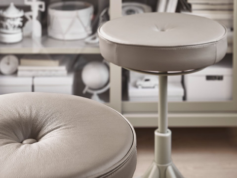 Sit more freely with TROLLBERGET active sit/stand support from IKEA. It has a 360-degree tilt, a circular foam seat covered in beige leather and a metal base.