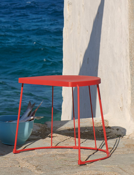 This red IKEA TRANARÖ stool for both indoor and outdoor use doubles as a side table.