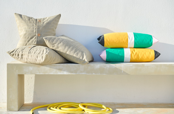 Beige IKEA FESTHOLMEN cushion covers are perfect for outdoor use as well – the fabric stays fresh for longer in the sun and it's also water repellent.