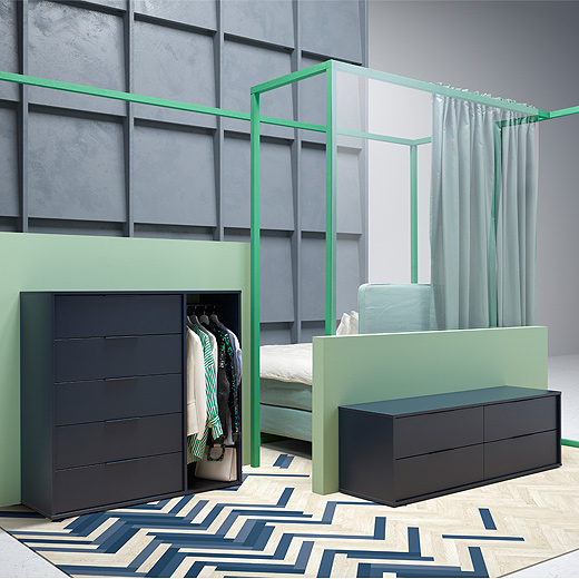 Get low, versatile storage with NORDMELA chest of four drawers from IKEA. In black-blue, it doubles as a bench and has a modern look. Shown in a bedroom, it can be used across the home, too.