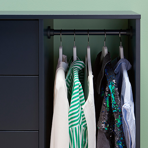 This close up of blue-black NORDMELA chest of drawers from IKEA shows its clothes rail and some of its five drawers. With clean lines It's great storage for a bedroom or across the home.