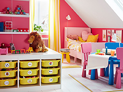 Organise your children's toys with IKEA TROFAST white storage combination unit with colourful plastic bin shelves with different depths to store bulky items and crafts.