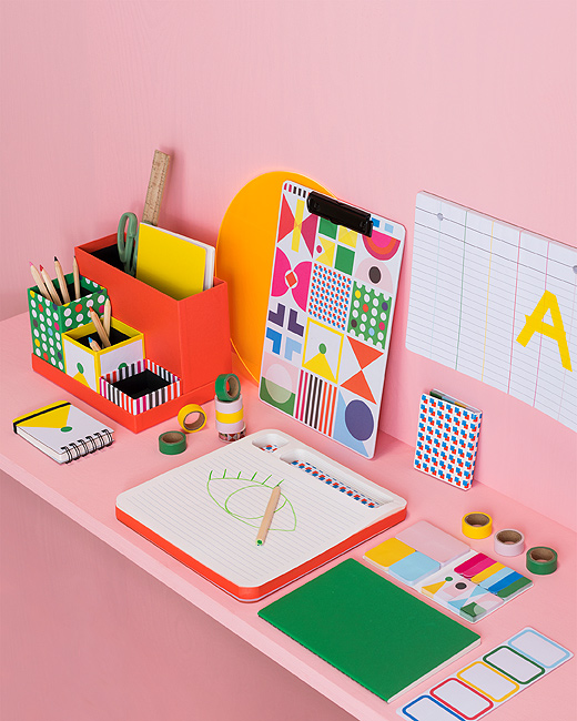 Work in a playful, sorted way with KNALLGUL desk organiser from IKEA. The five loose, paper boxes come in solid red and other brightly coloured geometric patterns. They're shown with other KNALLGUL stationery.