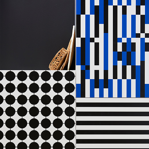 A close up of YTTERBYN kitchen doors from IKEA shows their retro, geometrical designs in black, blue and white. Each door has a different look like connected dots, horizontal stripes and disjointed lines.