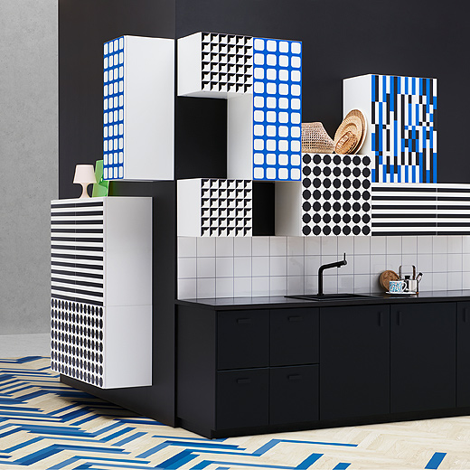 Personalise your kitchen with the graphic patterns of YTTERBYN doors from IKEA. Each size has a white background with a unique 1970s-based design like a blue grid, black stripes, black dots and more.