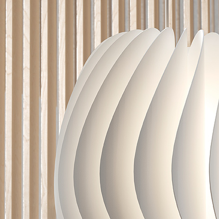 A close up of a white SKYMNINGEN pendant lamp from IKEA shows its striking construction of twenty, wafer-thin curved blades. The hidden light source emits a halo effect sideways and a concentrated pool downward.