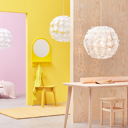 Hang up a statement in a home office, hallway, living room, wherever with a GRIMSÅS white pendant lamp from IKEA. Its glope shape comes from eighty-four arms capped with shapes resembling abstract flowers.