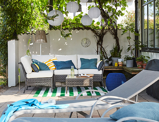 IKEA KUNGSHOLMEN modular outdoor seating furniture series is so comfortable, it's like you didn't even leave the living room. Couple it with bright bath towels, plants and paper lanterns for an all-day outdoor look.