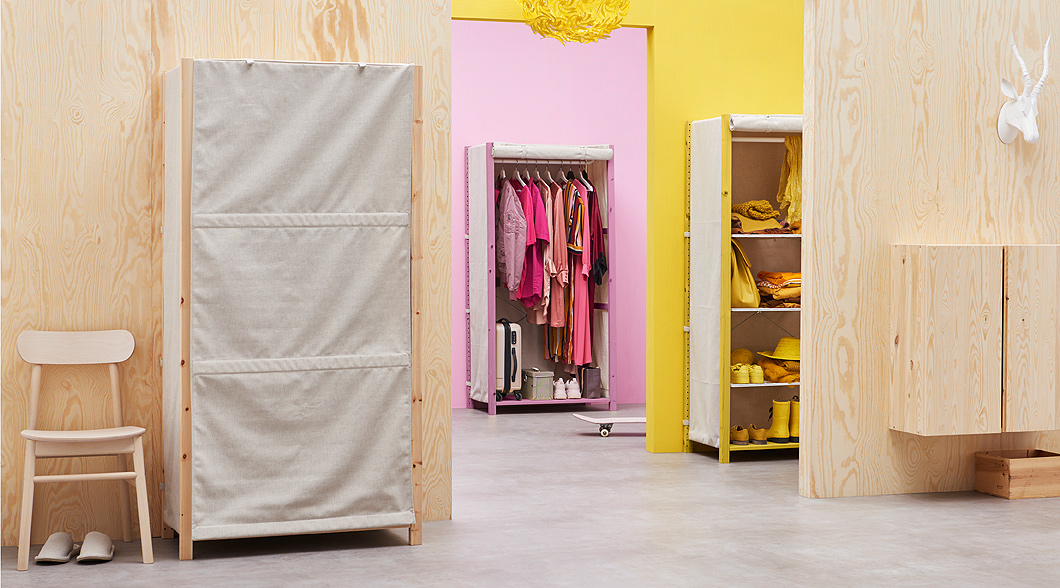 Transform IVAR storage into a wardrobe with IVAR cover from IKEA. The roll-up cover with a beige colour attaches easily without tools and hides your things. You can also add a clothes rail and wire shelf.