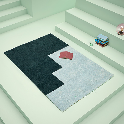 Take your floor style to another level with the asymmetric staircase pattern of KONGSTRUP rug from IKEA. The rectangular rug has a high pile with tones of darker green and light blue polypropylene.