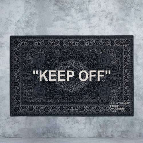 "A black Persian rug with the words ""keep off"" woven on it, designed by Virgil Abloh for IKEA ART 2019."