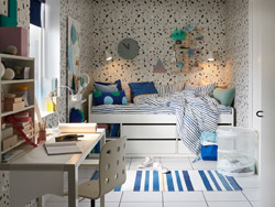 IKEA SLÄKT white bed frame can fit into small space bedrooms for teenagers and pre-teens alike. It has four sliding drawers and two open shelves to display items or books.