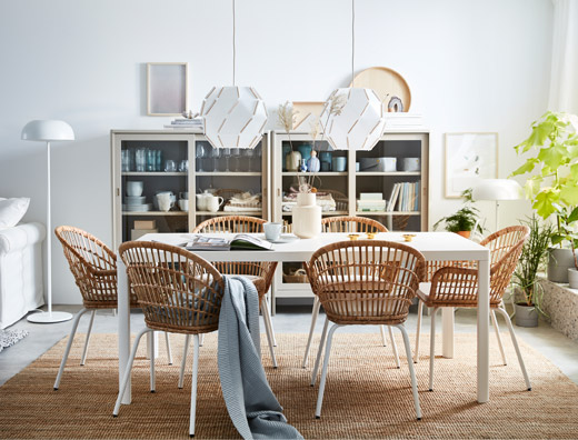 Complete your dining room or dining area with new NILSOVE rattan chairs with armrests. The natural woven fibres in each chair are individually weaved, making each unique.