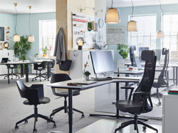 Create a healhty work life balance with ergonomic and comfortable furniture like JÄRVFJÄLLET adjustable black work chair and BEKANT smooth white desk.