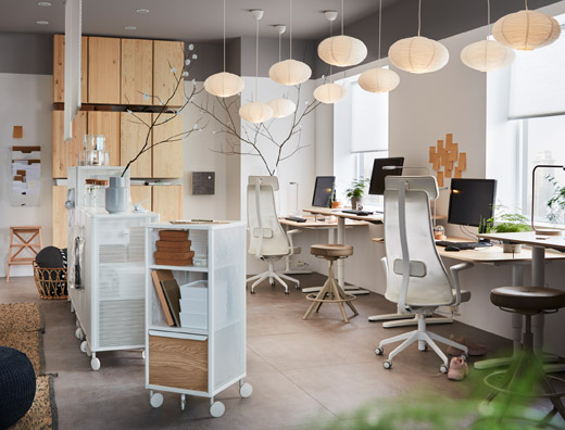 This small office is furnished with ergonomic IKEA JÄRVFJÄLLET swivel chairs, IVAR pine storage cabinets and BEKANT pine veneer work desks for a modern look.