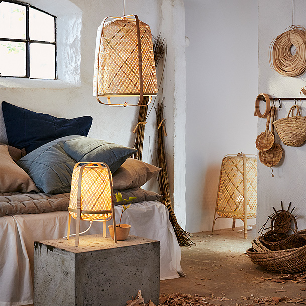 KNIXHULT floor, pendant and table lamps in natural woven bamboo designs are shown in a white room.