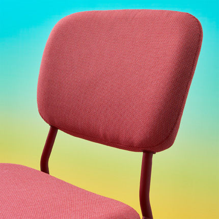 A close-up on the upholstered backrest and seat of KARLJAN chair with a metal frame.